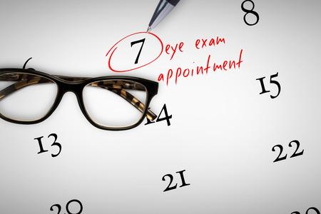 reading glasses: eye exam appointment against reading glasses