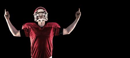 triumphing: American football player triumphing  against black