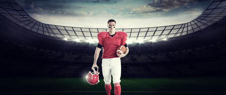 uniform green shoe: Portrait of american football player walking and holding football and helmet against rugby stadium