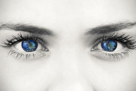blue face: Blue eyes on grey face against earth