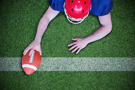 touchdown: American football player scoring a touchdown against pitch with line
