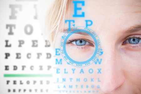 Pretty blonde applying contact lens against interface