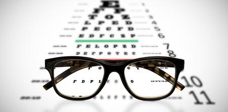 eye test: Reading glasses against eye test Stock Photo