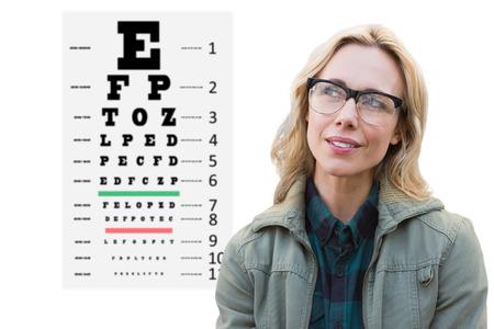 sense of sight: Pretty blonde thinking against eye test