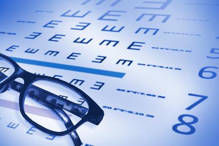 sense of sight: Reading glasses against eye test Stock Photo