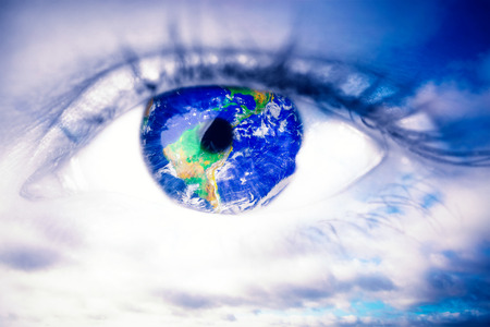 blue eye: Blue eye against blue sky with clouds Stock Photo