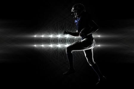 runing: Silhouette American football player runing against spotlights