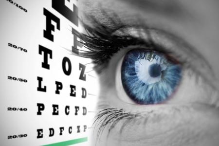 blue eye: Blue eye on grey face against eye test Stock Photo