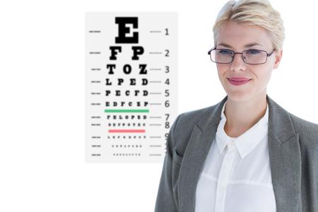 sense of sight: Portrait of beautiful businesswoman wearing glasses against eye test