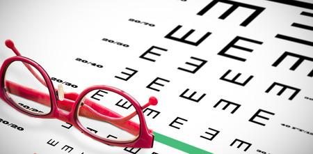 reading glasses: Reading glasses against eye test Stock Photo