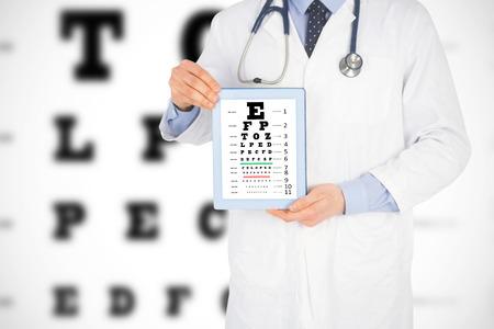 eye test: Doctor showing a digital tablet against eye test