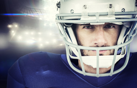 stern: Portrait of stern American football player against american football arena Stock Photo