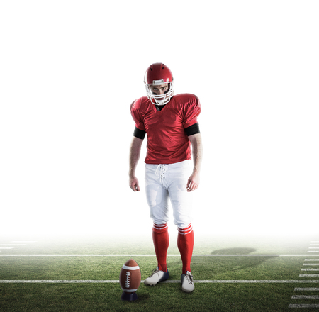 football pitch: Portrait of american football player against american football pitch