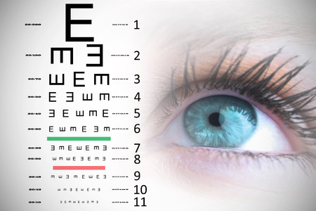 eye test: Blue eye against eye test Stock Photo