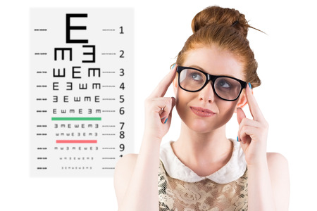 eye test: Hipster redhead looking up thinking against eye test