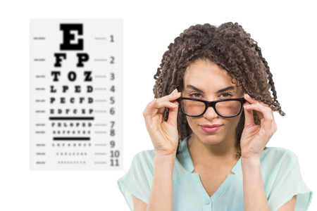 woman wearing glasses: Woman wearing glasses on white background against eye test