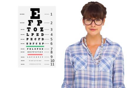 eye test: Pretty woman in glasses against eye test