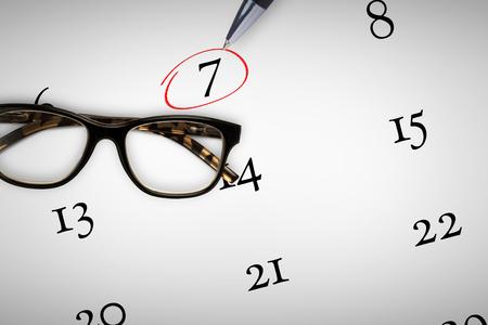 reading glasses: Reading glasses against pen Stock Photo