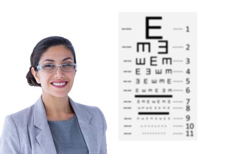 eye test: Portrait of smiling businesswoman wearing glasses against eye test