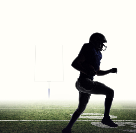 runing: Silhouette American football player runing against american football posts