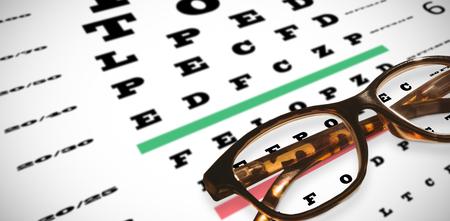 sight chart: Reading glasses against eye test Stock Photo