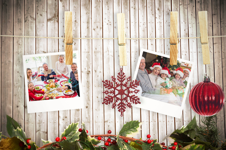 string together: Hanging christmas photos against wooden planks background
