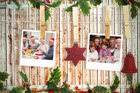 pale wood: Hanging christmas photos against wooden background in pale wood Stock Photo