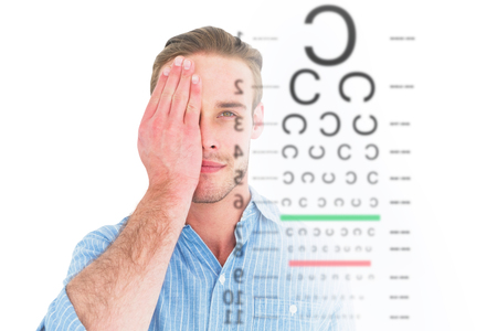 unsmiling: Unsmiling patient looking at camera with one eye against eye test