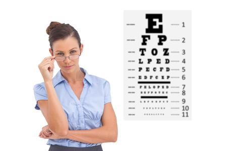 sense of sight: Businesswoman adjusting her glasses against eye test