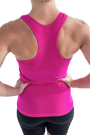 hands on hips: Rear view of muscular woman with hands hips on white background