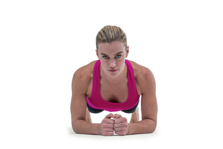 plank position: A muscular woman on a plank position on white background