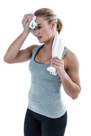 body concern: Muscular woman wiping herself with towel on white background