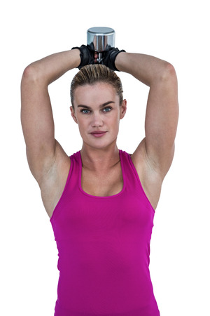 weightlifting gloves: Muscular woman exercising with dumbbells against white background