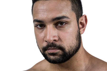 Muscular man frowning at camera on white background Stock Photo
