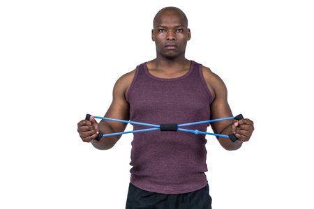 resistance: Fit man exercising with resistance band on white background