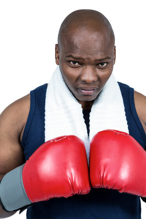 punched out: Fit man boxing with gloves on white background