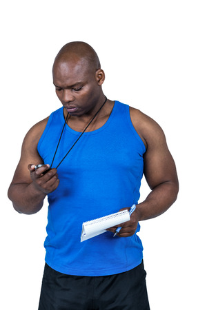 adult  body writing: Fit trainer checking his stopwatch on white background
