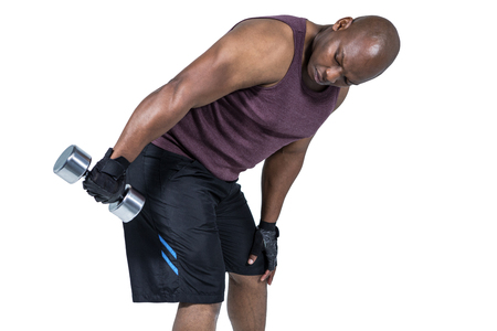 Fit man exercising with dumbbell on white background