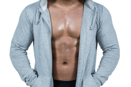 hooded: Muscular man in hooded jumper on white background