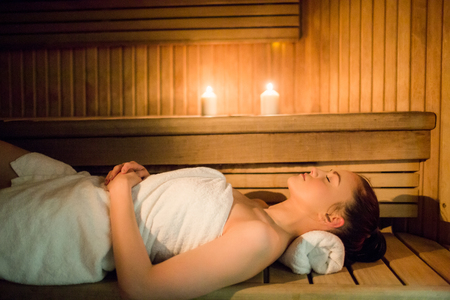sauna: Pretty woman relaxing in the sauna in the spa