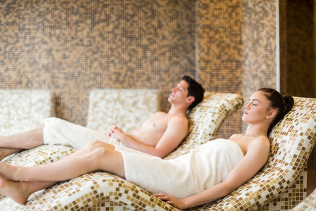 suite: Couple relaxing in the thermal suite at the spa