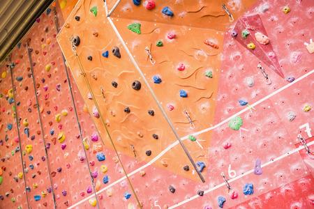 rock wall: Rock climbing wall at the gym Stock Photo