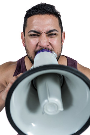 man yelling: Muscular man yelling through a megaphone against white background