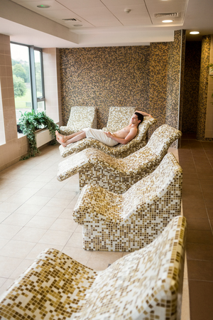 suite: Handsome man relaxing in thermal suite at the spa Stock Photo