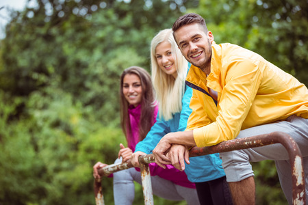 hiking: Happy friends on hike together in the countryside Stock Photo