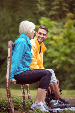 adventuring: Happy couple on a hike in the countryside