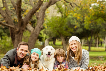 Young family with a dog on an autumns day