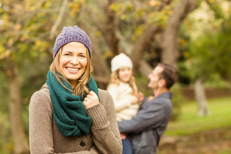 husband: Smiling woman against her husband and her daughter on an autumns day