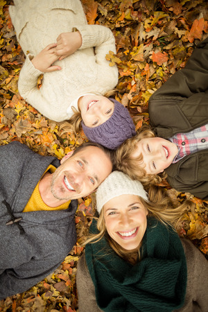 young  family: Smiling young family doing a head circles on an autumns day Stock Photo