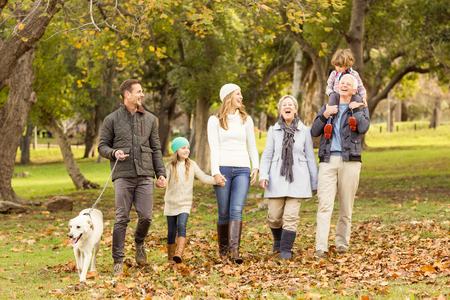 Extended family posing with warm clothes on an autumns day